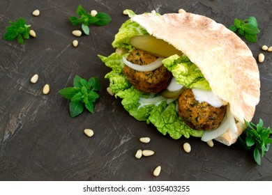 Arabic food. Hummus and falafel on a gray background.