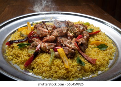 Arabic food: Kabsa consists of Rice with Chicken Shish Kabob it is a Traditional food in arabian region