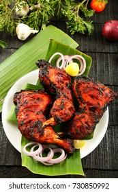 Arabic food- spicy tandoori chicken with traditional recipe.