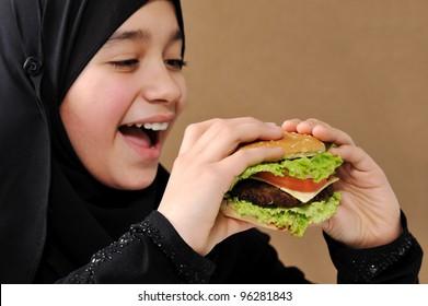 Arabic girl eating burger