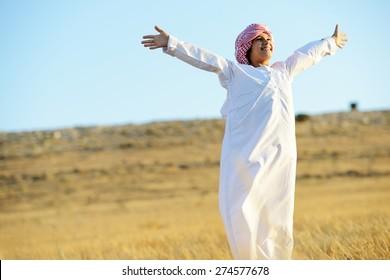 Arabic happy child in nature