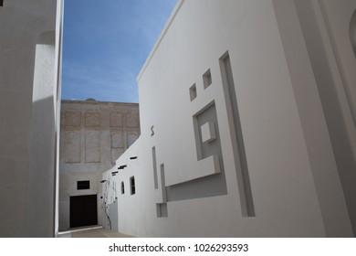 An Arabic inscription adorns the outer wall of this mosque in Muharraq, Bahrain.
