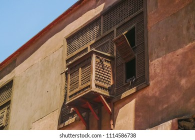 Arabic and Islamic Wooden Mashrabiya  Patterns in old building in Cairo which is is a type of projecting oriel window enclosed with carved wood latticework located on the second story of a building.