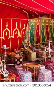 Arabic jaima with tables and smoking hookahs and tea