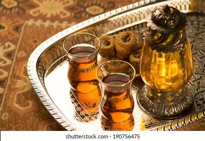 Arabic lantern, sweet and tea still life