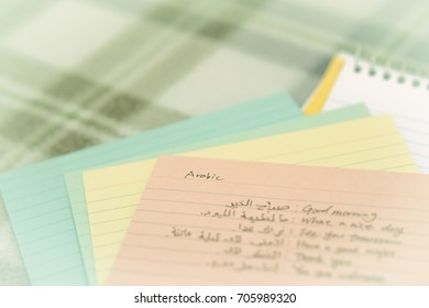Arabic; Learning New Language Writing Greetings on the Notebook