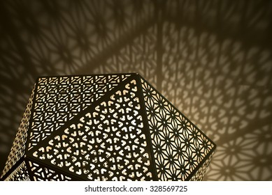 Arabic Lights with shadows against wall