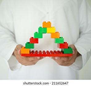 Arabic man conceptual building