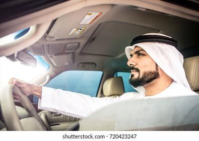 Arabic man in his luxury car