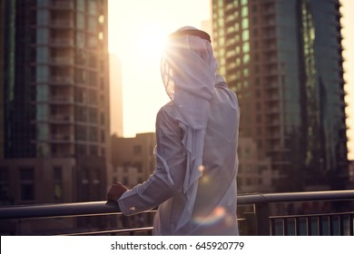 Arabic man looking to the sunrise, sunset Dubai