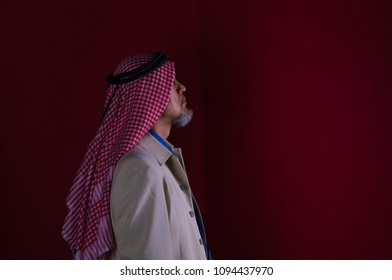arabic man in red scarf