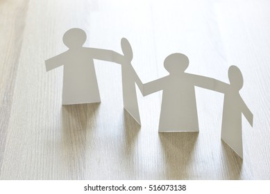 Arabic men holding each other's hand. 'Paper people' figure of emirati men. A symbol of unity.