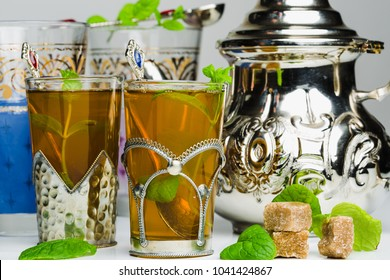 Arabic mint tea in a traditional decorated cup