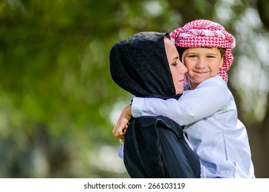 Arabic mother and son outdoors.Middle East.