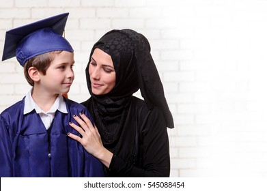 f1f10f4d85a Arabic mother and son are preparing to graduation ceremony.