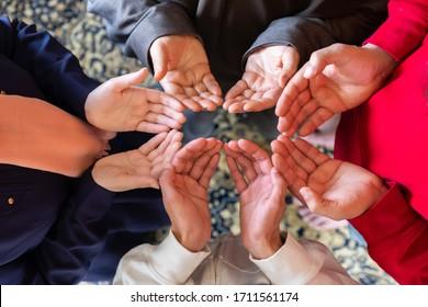 Arabic muslim family praying for god