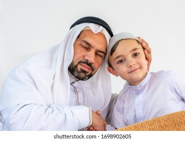 Arabic muslim father and son feeling happy together