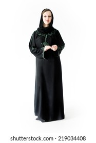 Arabic Muslim girl wearing black robe over white background posing