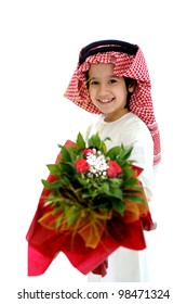 Arabic Muslim kid with bouquet of flowers
