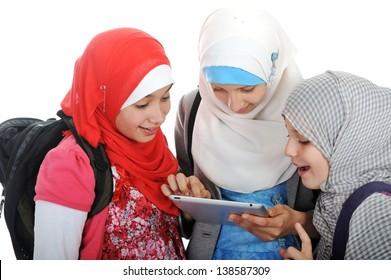 Arabic Muslim school girls working together on tablet pc