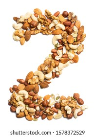 "Arabic numeral ""2""   from  peeled hazelnut  on a white isolated background. Food pattern made from nuts. bright  numeral for design."