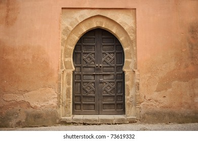 Arabic old style door to a house in an orange wall