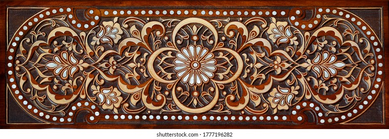 Arabic patterns carved from wood on the door. Eastern architectural design.