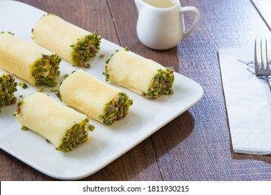 """Arabic sweets with cheese or as it's called: """"Halawa bil jubn"""" or """"Halawe bl jebn"""" or """"Halaweh biljebn"""" with Cream (keshta) and sugar syrup  syrian traditional sweets"""
