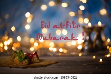 Arabic sweets on a wooden surface. Eid al-Fitr Mubarak. Feast for breaking Ramadan fasting