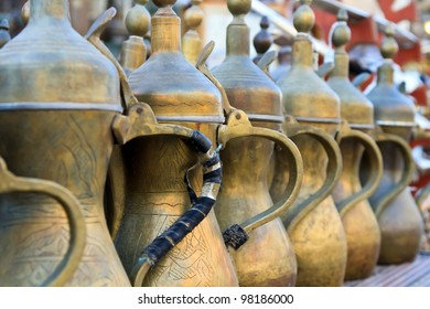 Arabic tea pots made of brass lined up for sale at the souk