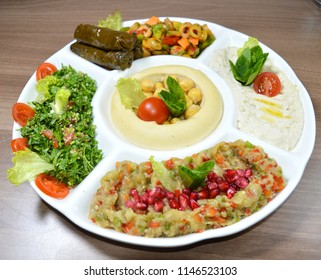 Arabic traditional Hummus , labneh and mtabbal isolated