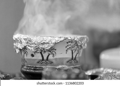 Arabic traditional incense bukhoor agar wood burner in with smoke, used in majlis, Ramadan and Eid occasions