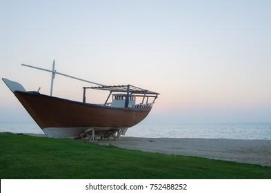 Arabic traditional wooden boat. Dawn time in Al Jubail in Saudi Arabia