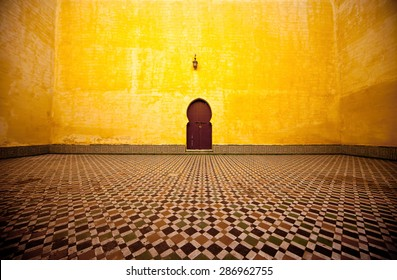 Arabic typical entry on a yellow wall