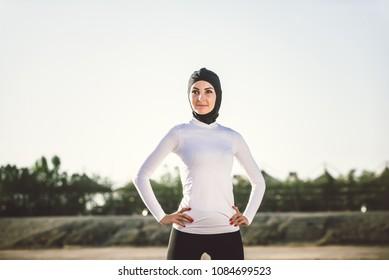 Arabic woman running outdoor and wearing hijab