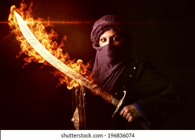 Arabic Woman warrior with sword on fire against a dark background