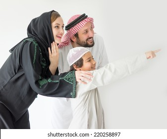 Arabic young family pointing