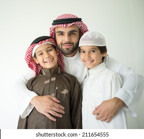 Arabic young father posing with kids