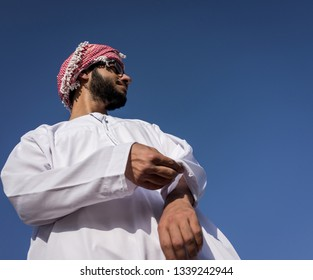 Arabic young man against blue sky