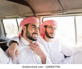 Arabic young men in travel on back seat