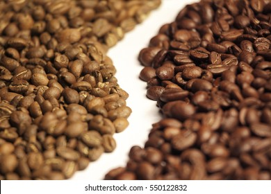 Arabica and robusta coffee beans side by side