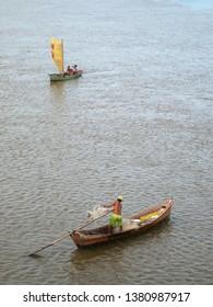 Aracaju/Sergipe/Brazil - April 11, 2009: two little boats with some fishermen.