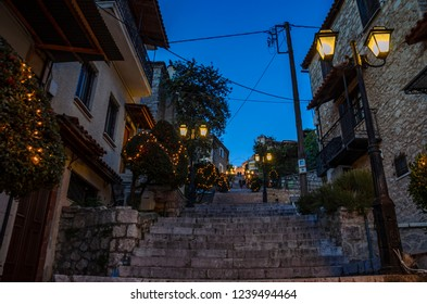 ARACHOVA, BOEOTEA - GREECE, DECEMBER 2015: Scenic view of Arachova Village decorated for Christmas. Arachova is a picturesque village with a panoramic view, uphill small houses and cobbled streets