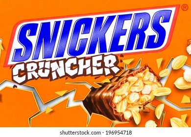 ARAD, ROMANIA - April 9, 2012: The name Snickers Cruncher printed on cardboard box. Studio shot.