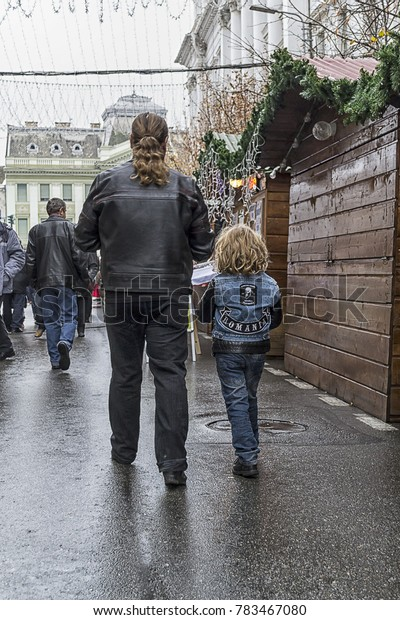ARAD, ROMANIA - DECEMBER 01, 2012: Father and son walking. Rear view. From behind. Real people.