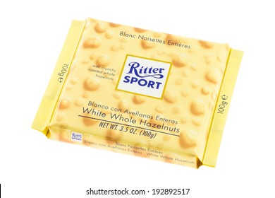 ARAD, ROMANIA - February 12, 2012: Ritter Sport White Chocolate with Whole Hazelnuts. Studio shot, isolated on white background.