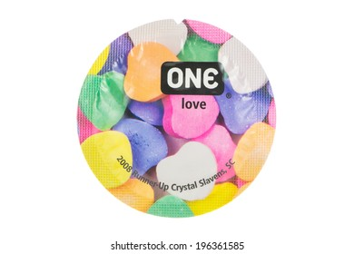 ARAD, ROMANIA - June 1, 2014: ONE Condom. The ONE Condoms brand is owned by Global Protection Corp. from Boston, Massachusetts. Studio shot, isolated on white background.