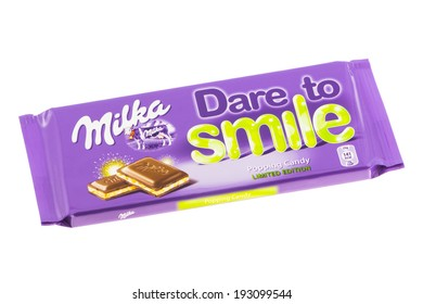 ARAD, ROMANIA - May 16, 2012: Milka Dare to Smile Chocolate. Studio shot, isolated on white background.