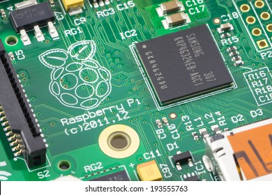 ARAD, ROMANIA - May 18, 2014: Close-up of a Raspberry Pi Model-B Rev2. The Raspberry Pi is a credit-card-sized single-board computer developed in the UK by the Raspberry Pi Foundation. Studio shot.