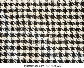 Arafat Scarve. Weaved texture of a material. Linen natural fabric, square pattern, close up. Silk pattern. Cotton weft or white yarn. Abstract texture. Vintage background of black and white elements